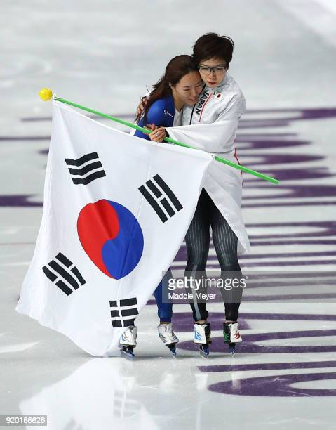 Gold medalist Nao Kodaira of Japan and silver medalist SangHwa Lee of Korea embrace after winning medals during the Ladies' 500m Individual Speed...