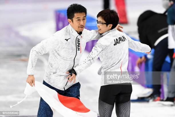 Gold medalist Nao Kodaira of Japan celebrates with her coach Masahiro Yuki after competing in the Speed Skating Ladies' 500m on day nine of the...