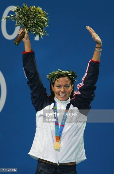 Gold medalist Natalie Coughlin of USA celebrates on the podium during the medal ceremony for the women's swimming 100 metre backstroke event on...