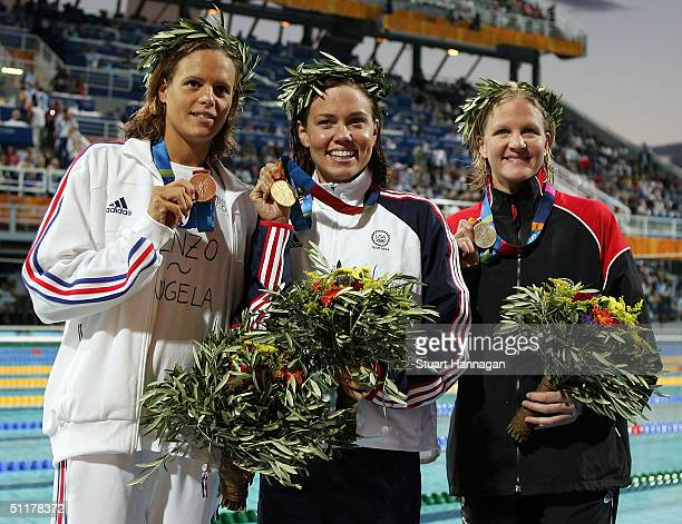 Gold medalist Natalie Coughlin of USA, silver medalist Kirsty Coventry of Zimbabwe and bronze medalist Laure Manaudou of France pose with their...
