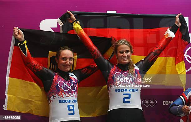Gold medalist Natalie Geisenberger and silver medalist Tatjana Huefner of Germany celebrate after the Women's Luge Singles on Day 4 of the Sochi 2014...