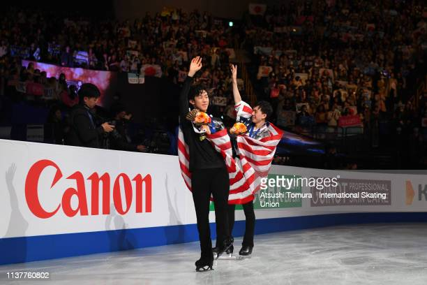 Gold medalist NathanChen of the United States and bronze medalist VincentZhou of the United States lap the rink after the medal ceremony for the...