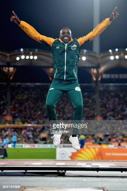 Gold medalist Ndodomzi Ntutu of South Africa celebrates during the medal ceremony for the Men's T12 100 metresduring athletics on day eight of the...