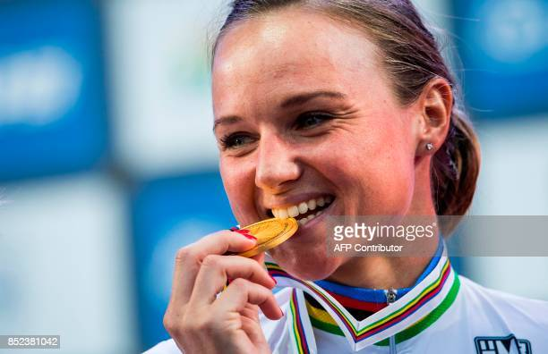 Gold medalist Netherlands' Chantal Blaak poses with her medal after winning the women elite road race of the UCI Cycling Road World Championships in...