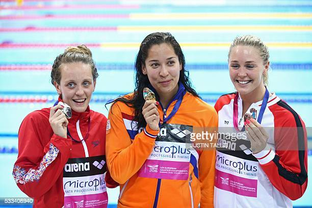 Gold medalist Netherlands' Ranomi Kromowidjojo poses for a photograph with silver medalist Britain's Francesca Halsall and bronze medalist Denmark's...