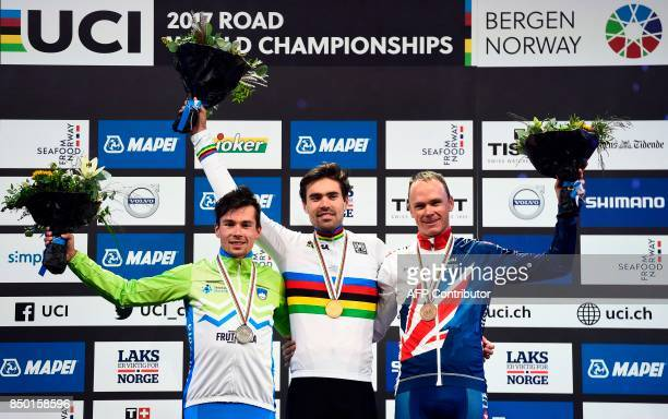 Gold medalist Netherlands' Tom Dumoulin silver medalist Slovenia's Primoz Roglic and bronze medalist Great Britain's Chris Froome celebrate on the...