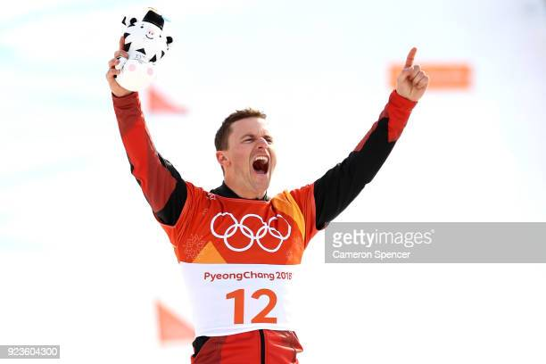 Gold medalist Nevin Galmarini of Switzerland poses during the victory ceremony for the Men's Snowboard Parallel Giant Slalom on day fifteen of the...