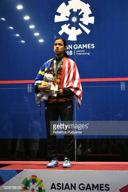 Gold medalist Nicol Ann David of Malaysia celebrates on the podium during Women's Squash Singles victory ceremony on day eight of the Asian Games on...