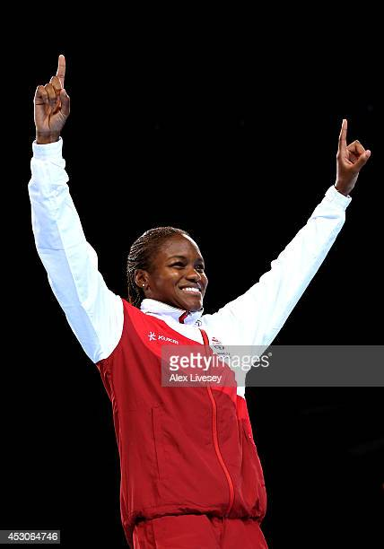 Gold medalist Nicola Adams of England celebrates during the medal ceremony for the Women's Fly Final at SSE Hydro during day ten of the Glasgow 2014...