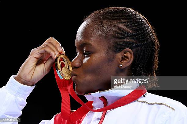 Gold medalist Nicola Adams of England kisses her medal during the medal ceremony for the Women's Fly Final at SSE Hydro during day ten of the Glasgow...