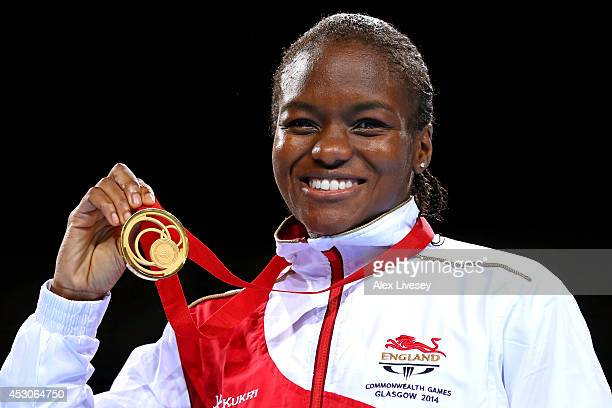 Gold medalist Nicola Adams of England poses during the medal ceremony for the Women's Fly Final at SSE Hydro during day ten of the Glasgow 2014...