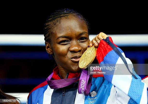 Gold medalist Nicola Adams of Great Britain celebrates on the podium during the medal ceremony after winning the Women's Fly Boxing final bout on Day...