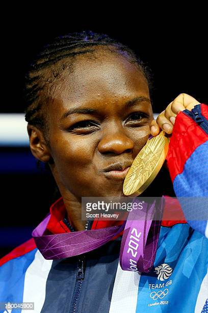 Gold medalist Nicola Adams of Great Britain celebrates on the podium during the medal ceremony after the Women's Fly Boxing final bout on Day 13 of...