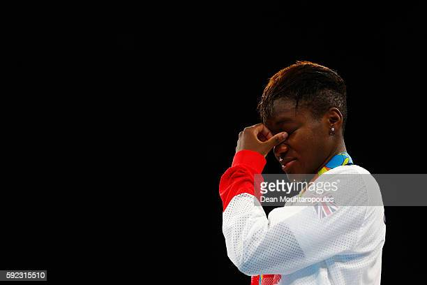 Gold medalist Nicola Adams of Great Britain poses during the medal ceremony for the Women's Fly on Day 15 of the Rio 2016 Olympic Games at Riocentro...