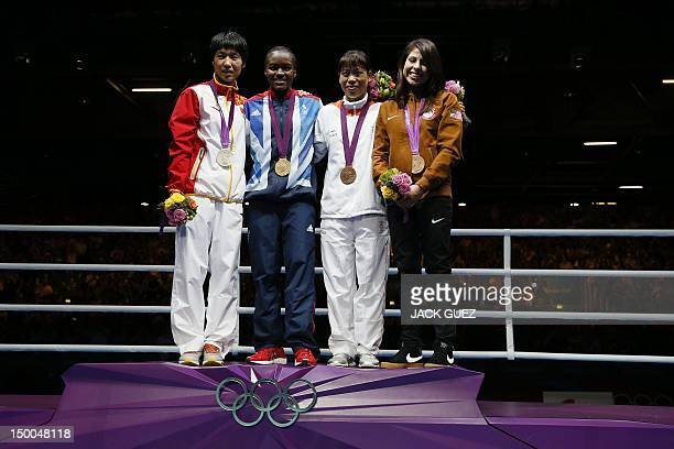 Gold medalist Nicola Adams of Great Britain stands with Silver medalist Cancan Ren of China Bronze medalists Mary Kom Hmangte of India and Marlene...