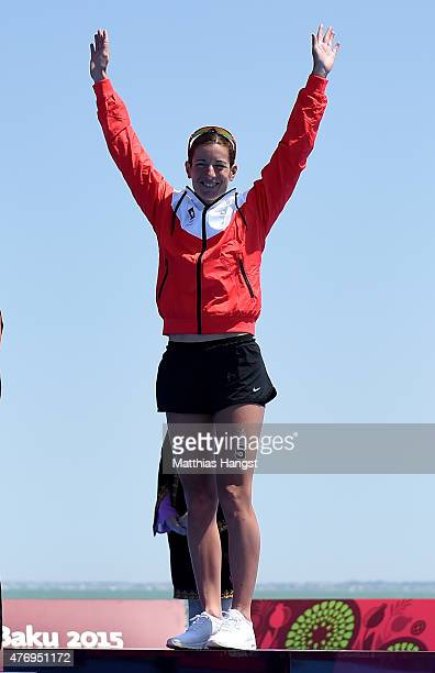 Gold medalist Nicola Spirig of Switzerland steps onto the podium prior to receiving her medal following the Women's Triathlon Final during day one of...