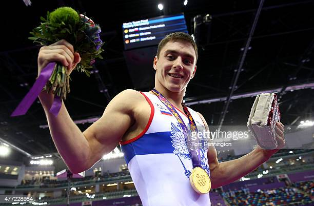 Gold medalist Nikita Ignatyev of Russia celebrates after the medal ceremony for the Men's Team Final on day three of the Baku 2015 European Games at...
