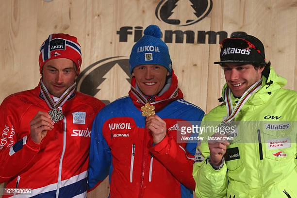 Gold medalist Nikita Kriukov of Russia poses with Silver medalist Petter jr Northug of Norway and Bronze medalist Alex Harvey of Canada at the medal...