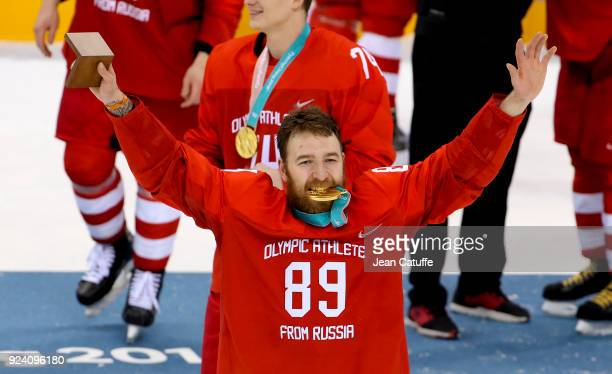 Gold medalist Nikita Nesterov of OAR celebrates after victory following the Men's Ice Hockey Gold Medal match between Germany and Olympic Athletes...