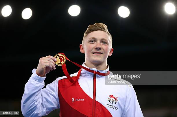 Gold medalist Nile Wilson of England poses during the medal ceremony for the Men's Horizontal Bar Final at SSE Hydro during day nine of the Glasgow...