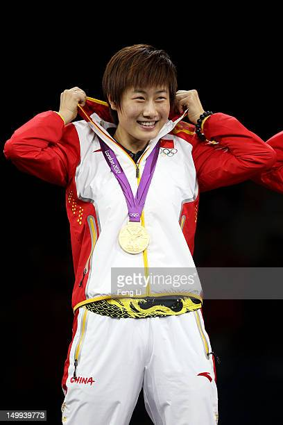 Gold medalist Ning Ding of China celebrates on the podium during the medal ceremony for the Women's Team Table Tennis on Day 11 of the London 2012...