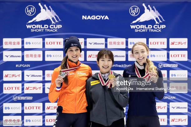 Gold medalist Noh Ah Rum of South Korea celebrates with silver medalist Suzanne Schulting of the Netherlands and bronze medalist Kristen Santos of...
