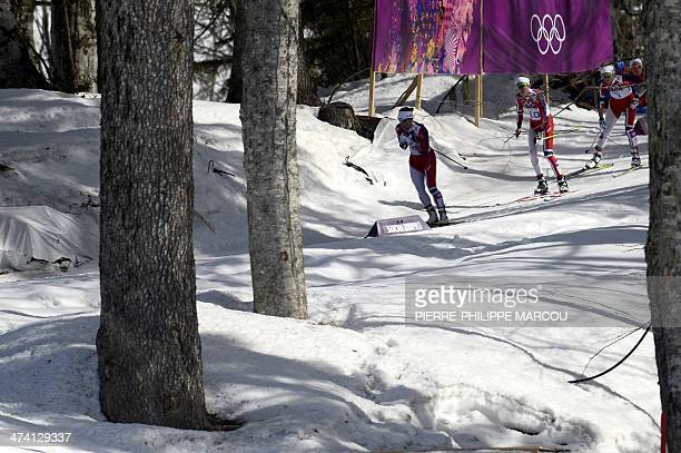 Gold medalist Norway's Marit Bjoergen leads bronze medalist Norway's Kristin Stoermer Steira and silver medalist Norway's Therese Johaug as they...
