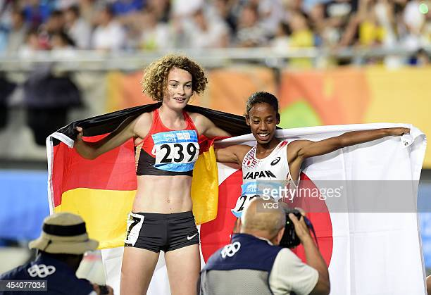 Gold medalist Nozomi Musembi Takamatsu of Japan and Silver medalist Alina Reh of Germany celebrate after the Women's 3000m Final on day eight of the...