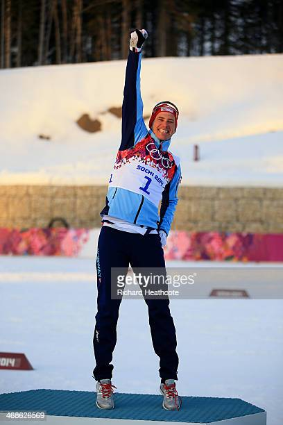 Gold medalist Ola Vigen Hattestad of Norway celebrates on the podium during the flower ceremony for the Finals of the Men's Sprint Free during day...