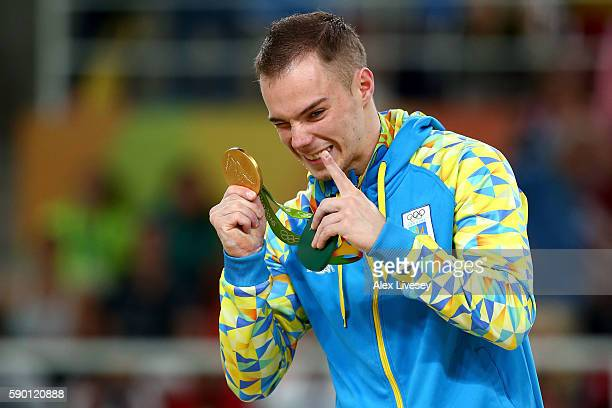 Gold medalist Oleg Verniaiev of Ukraine poses for photographs at the medal ceremony for the Parallel Bars on Day 11 of the Rio 2016 Olympic Games at...