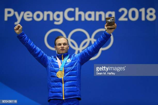 Gold medalist Oleksandr Abramenko of Ukraine celebrates during the medal ceremony for the Freestyle Skiing - Men's Aerials on day 10 of the...