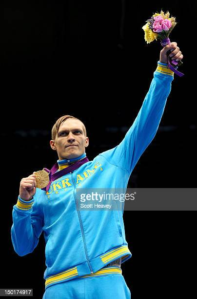 Gold medalist Oleksandr Usyk of Ukraine celebrates on the podium during the medal ceremony for the Men's Heavy Boxing final bout on Day 15 of the...