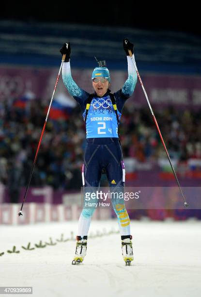 Gold medalist Olena Pidhrushna of Ukraine celebrates as she crosses the finish line to win the Women's 4 x 6 km Relay during day 14 of the Sochi 2014...