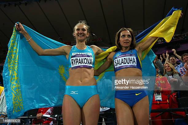 Gold medalist Olga Rypakova of Kazakhstan and bronze medalist Olha Saladuha pose afte competing in the Women's Triple Jump on Day 9 of the London...
