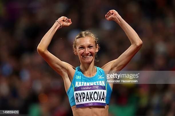 Gold medalist Olga Rypakova of Kazakhstan in the Women's Triple Jump celebrates on Day 9 of the London 2012 Olympic Games at the Olympic Stadium on...