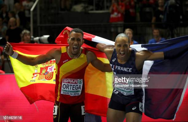 Gold medalist Pascal MartinotLagarde of France and Bronze medalist Orlando Ortega of Spain celebrate following the Men's 110m Hurdles final during...