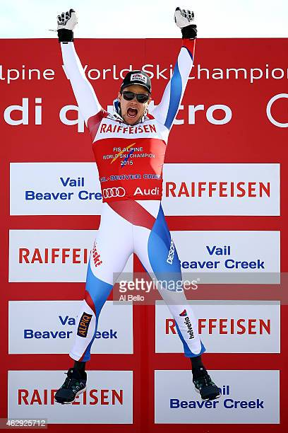 Gold medalist Patrick Kueng of Switzerland celebrates on the podium after the finish of the Men's Downhill in Red Tail Stadium on Day 6 of the 2015...