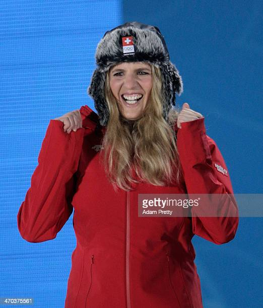 Gold medalist Patrizia Kummer of Switzerland celebrates during the medal ceremony for the Women's Parallel Giant Slalom on day twelve of the Sochi...