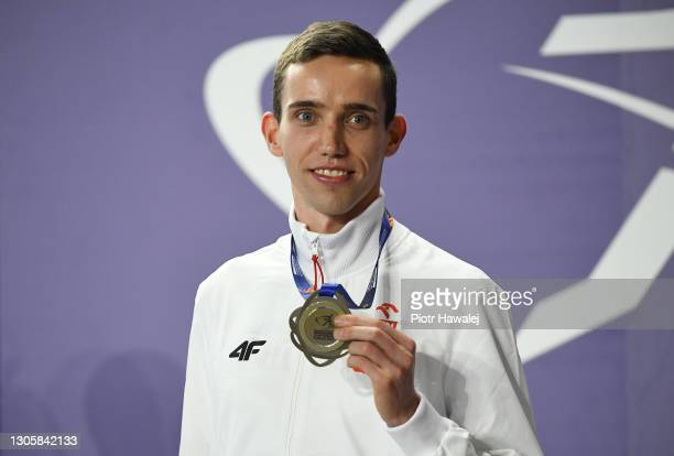 Gold medalist Patryk Dobek of Poland poses for a photo during the medal ceremony for Men's 800 metres during the second session on Day 3 of the...