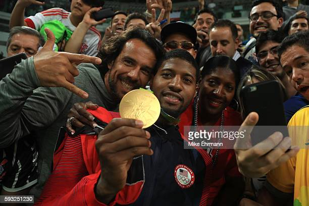 Gold medalist Paul George of the United States celebrates with the crowd after defeating Serbia in the Men's Gold medal game on Day 16 of the Rio...