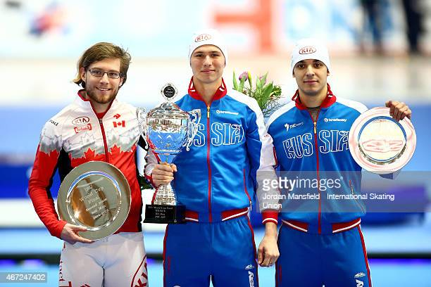 Gold medalist Pavel Kulizhnikov of Russia Silver medalist Laurent Dubreuil of Canada and Bronze medalist Ruslan Murashov of Russia pose for a photo...