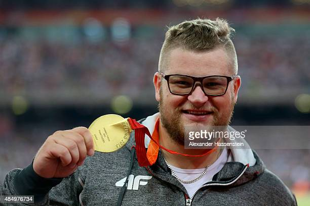 Gold medalist Pawel Fajdek of Poland poses on the podium during the medal ceremony for the Men's Hammer final during day two of the 15th IAAF World...