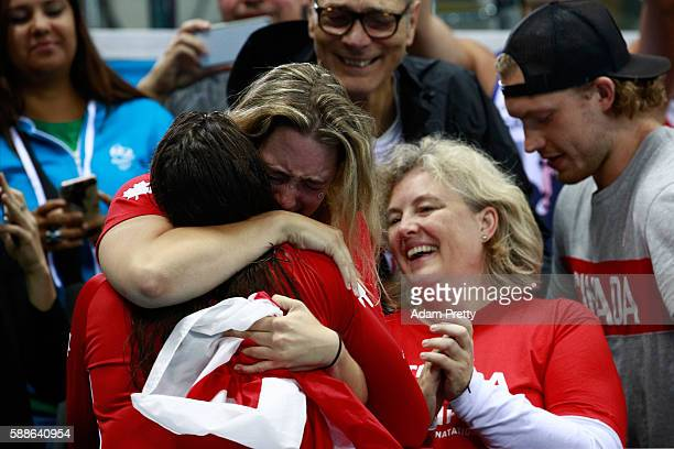 Gold medalist Penny Oleksiak of Canada celebrates during the medal ceremony for the Women's 100m Freestyle Final on Day 6 of the Rio 2016 Olympic...