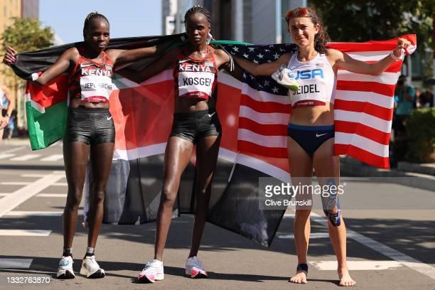 Gold medalist Peres Jepchirchir of Team Kenya, silver medalist Brigid Kosgei of Team Kenya and bronze medalist Molly Seidel of Team United States...