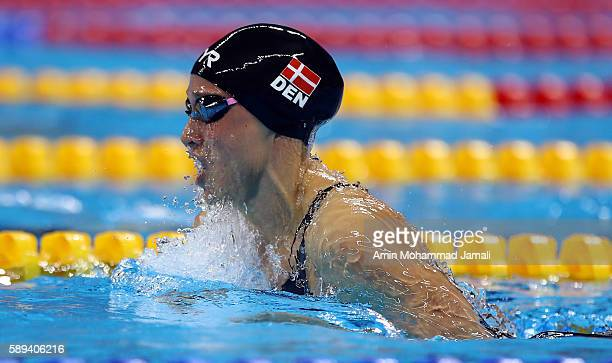 Gold medalist Pernille Blume of Denmark celebrates on the podium during the medal ceremony for the Women's 50m Freestyle Final on Day 8 of the Rio...