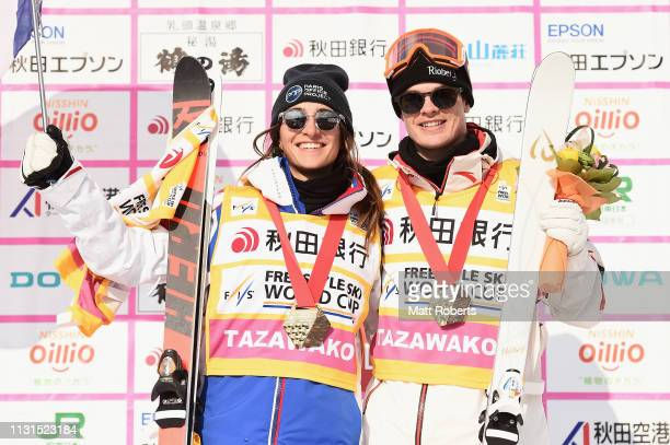 Gold medalist Perrine Laffont of France and gold medalist Mikael Kingsbury of Canada pose during the yellow jersey ceremony on day one of the FIS...