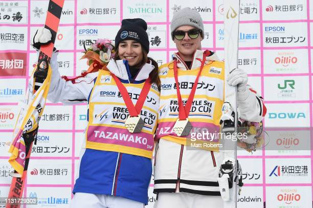 Gold medalist Perrine Laffont of France and gold medalist Mikael Kingsbury of Canada pose during the yellow jersey ceremony on day two of the FIS...