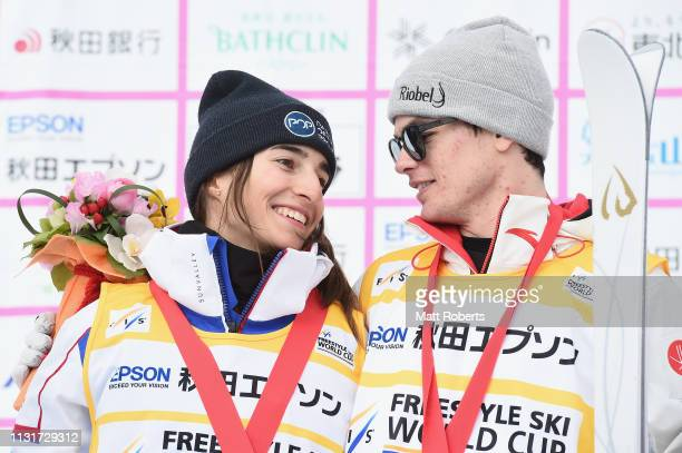 Gold medalist Perrine Laffont of France and gold medalist Mikael Kingsbury of Canada share a laugh during the yellow jersey ceremony on day two of...