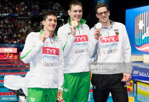 Gold medalist Peter Bernek of Hungary silver medalist Philip Heintz of Germany and bronze medalist Gergely Gyurta of Hungary pose with their medals...