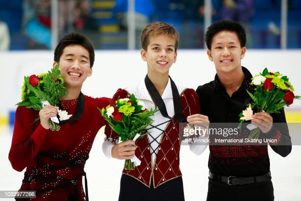 Gold medalist Petr Gumennik of Russia is surrounded by silver medalist Tomaki Hiwatashi of the USA and bronze medalist Adam Siao Him Fa of France...